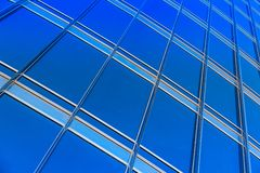 Modern blue glass wall of skyscraper Stock Photos