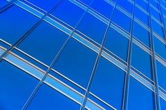 Modern blue glass wall of skyscraper Stock Photos