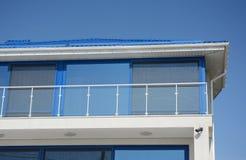 Modern blue house with glass balcony. Contemporary house disign. Modern house with glass balcony. Contemporary house disign royalty free stock photos