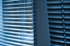 Modern blue plastic Shutter Blinds in room close-up Stock Image