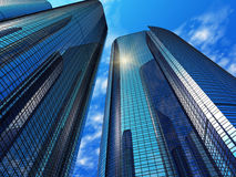 Modern blue reflective office buildings. In a sunny day Royalty Free Stock Photo