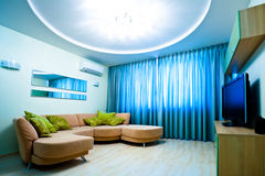 Modern blue room with TV and sofa Royalty Free Stock Photo