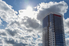 Modern blue and white stone condo tower on blue sky in the background Stock Photography