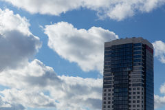 Modern blue and white stone condo tower Stock Images