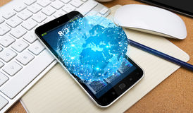 Modern blue world and mobile phone Stock Photography