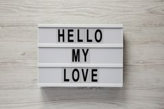Modern board with text `Hello my love` on a white wooden background, top view. Valentine`s Day 14 February. Close-up stock photo