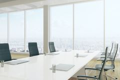 Modern boardroom interior. Side view of modern boardroom interior with equipment and panoramic city view. 3D Rendering Stock Images