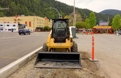 A modern bob-cat front-loader in british columbia. A machine being used in the construction of an intersection at harrison hot springs Royalty Free Stock Images