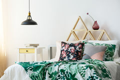 Modern bohemian interior with lamp. Modern bohemian bedroom interior with green accents and pendant lamp stock images
