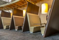 Modern booths in restaurant. Modern restaurant booth seats in brown shades royalty free stock photography