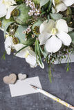 Modern bouquet with white orchid flowers and green poppy heads. Stock Images