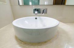 Modern bowl style white ceramic hand wash basin Stock Photos