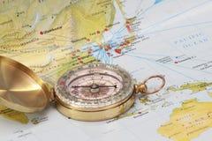Modern brass compass Stock Images