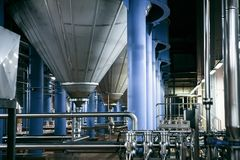 Modern brewer factory. Workshop of modern brewer factory, steel reservoirs Stock Photo