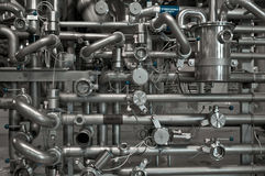 Modern brewery. Pipes for giving of malt and water Royalty Free Stock Photos