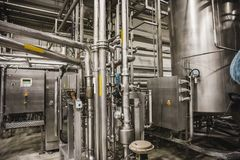 Free Modern Brewery Factory Interior.Steel Tanks Or Vats For Filtration Beer, Pipe Lines And Other Equipment Tool In Plant Workshop Royalty Free Stock Photography - 110790337