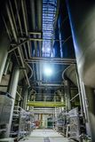 Modern brewery. Large vats for beer fermentation and maturation and pipeline for components delivery royalty free stock photos