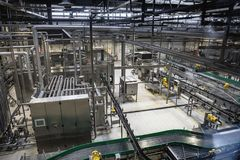 Modern brewery production line at beer factory. Steel tanks, equipment, pipelines and filtration system. Toned royalty free stock images