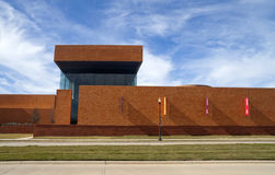 Modern Brick Building. A long modern brick building with a blue sky Stock Image