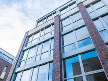 Modern Brick Building with Large Windows Stock Photography