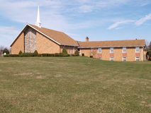 Modern brick church with grass lawn Stock Images