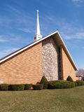 Modern brick church with white steeple royalty free stock images