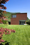 Modern brick house. Modern house a summer day, outdoors Royalty Free Stock Photography