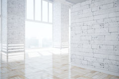 Modern brick interior with blank wall Royalty Free Stock Image