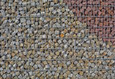 Modern brick pattern wall in pastell tone. Brilliant small and small stones in bright colors for garden decoration in sunny summer time royalty free stock photography