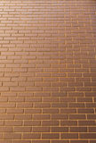 Modern brick wall in a bright sunny day as background. Look from Royalty Free Stock Photos