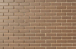 Modern brick wall in a bright sunny day as background Stock Images