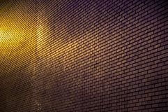 Modern brick wall with light in the city royalty free stock image