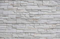Modern brick wall, slab stone pattern as background. Stock Photo