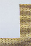 Modern brick wall with white painted plaster background Royalty Free Stock Photo