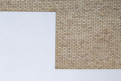Modern brick wall with white painted plaster background Royalty Free Stock Image
