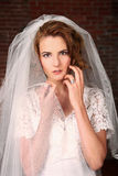 Modern Bride With Brick Background Royalty Free Stock Photos