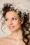 Modern bride with feather hairpin in her hair Royalty Free Stock Image