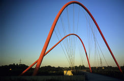 Modern bridge. Red colored, in the Nordsternpark in the city of Gelsenkirchen stock photos