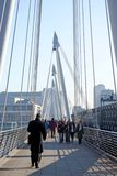 Modern Bridge. View of pedestrians crossing modern bridge royalty free stock photos