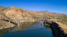 Modern bridge crosses the water in an Idaho reservoir Royalty Free Stock Image