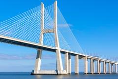 Modern bridge fragment: white against bright blue. Modern bridge fragment: Vasco da Gama Bridge (Ponte Vasco da Gama), Lisbon Royalty Free Stock Image