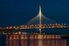 Modern bridge at night. Fragment of the Vantovy Bridge across the Petrovsky fairway. St. Petersburg, Russia. Long exposure photo royalty free stock images