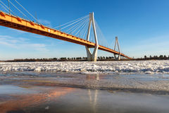 Modern bridge over the frozen river Royalty Free Stock Photography
