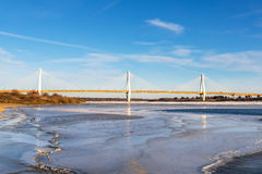Modern bridge over the frozen river Stock Photo