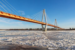 Modern bridge over the frozen river Royalty Free Stock Images