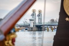 Modern bridge over the river near Kampen. Look through at the city bridge along old sailing boats on the IJssel quay of the Dutch city of Kampen Stock Image