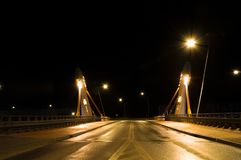 Modern bridge over street at night. Stock Photos