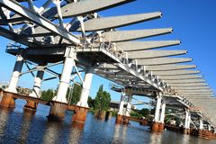 Modern bridge structure over water surface Stock Photo