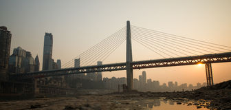 Modern bridge at sunset time. With city background Royalty Free Stock Images