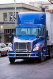 Modern bright blue semi truck with trailer and bumper Protection Stock Photography